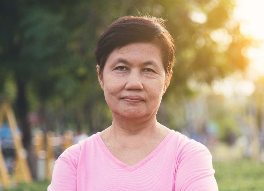 Asian older woman with very short hairstyle