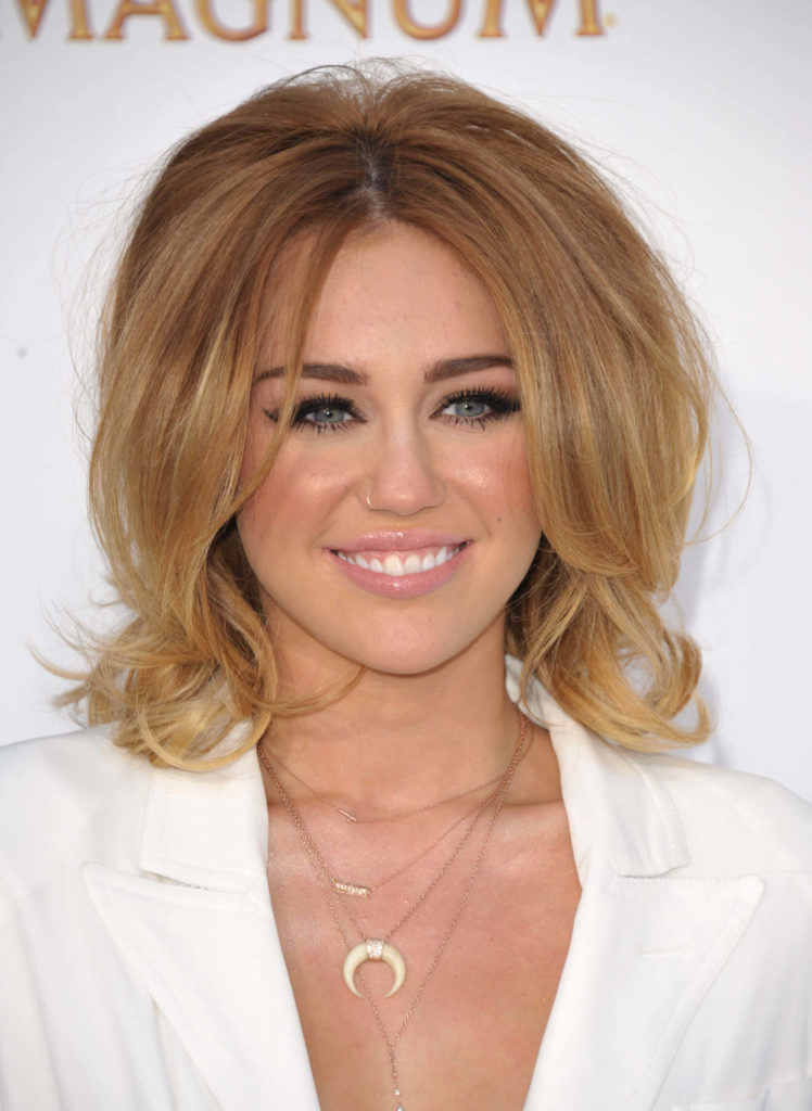 Get glamorous with formal layered bob hairstyle on light caramel brunette hair color with medium blonde highlights