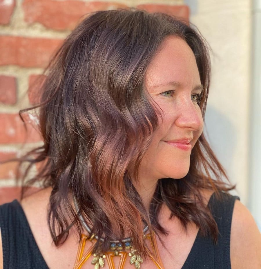brunette hairstyle with highlights for older women