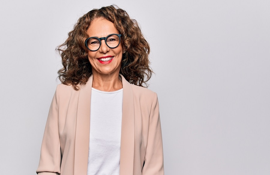 woman over 50 with curly brunette hairstyle