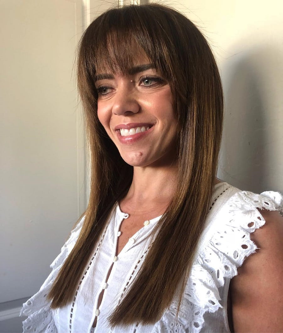 brunette hairstyle with bangs for women over 50