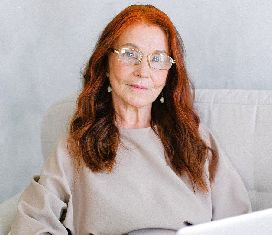 woman over 50 with colorful highlights