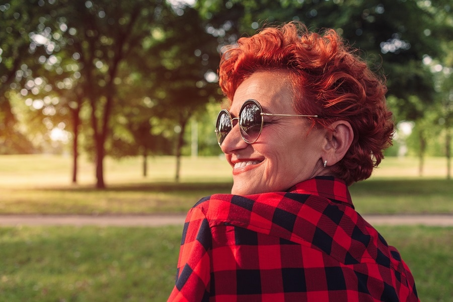 older woman with red short curly hair