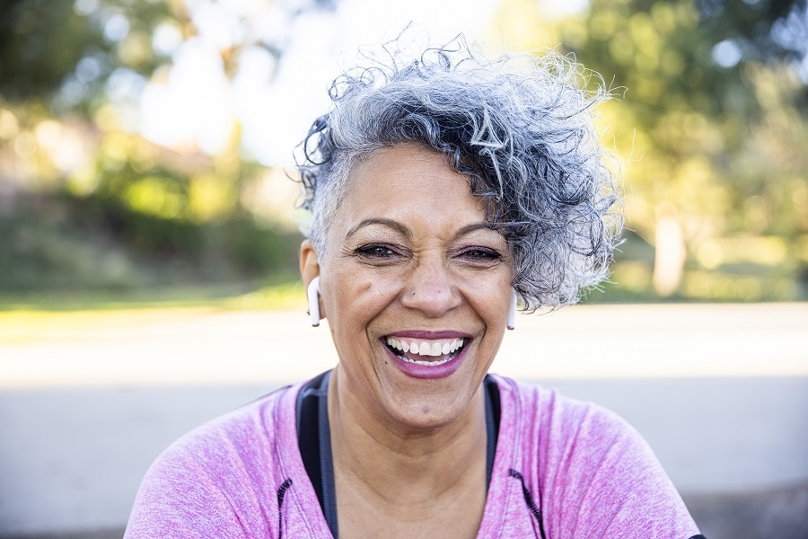 woman over 50 with two tone curly hair