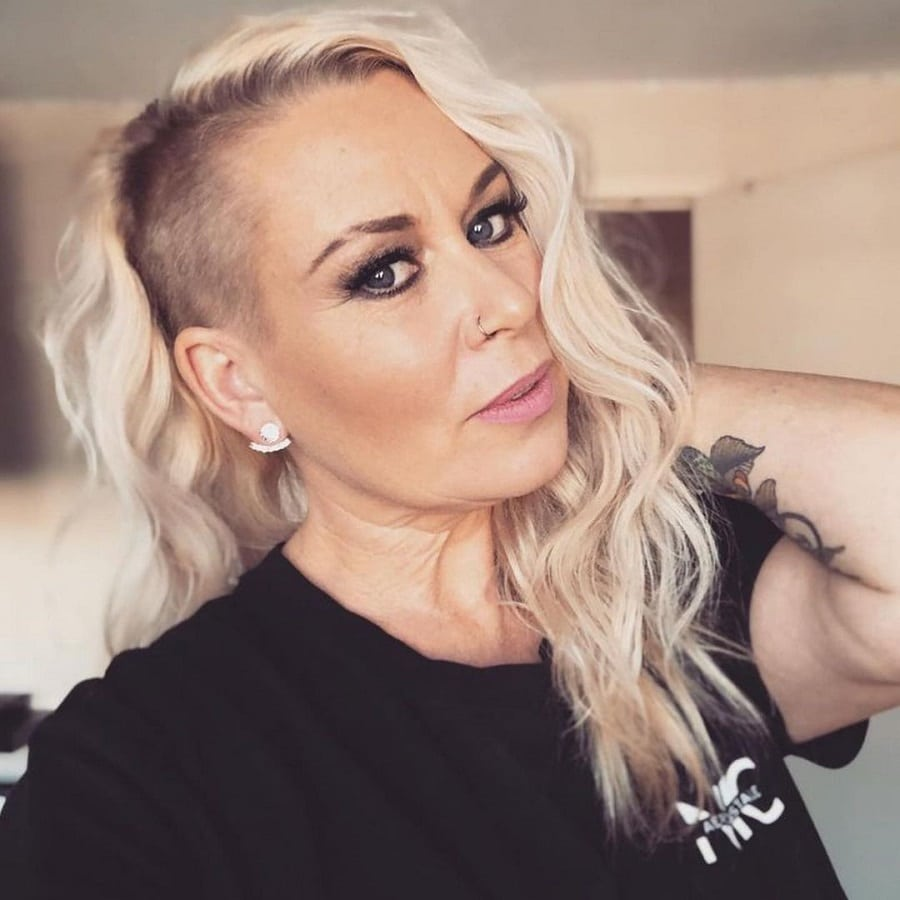 woman over 50 with blonde edgy hairstyle
