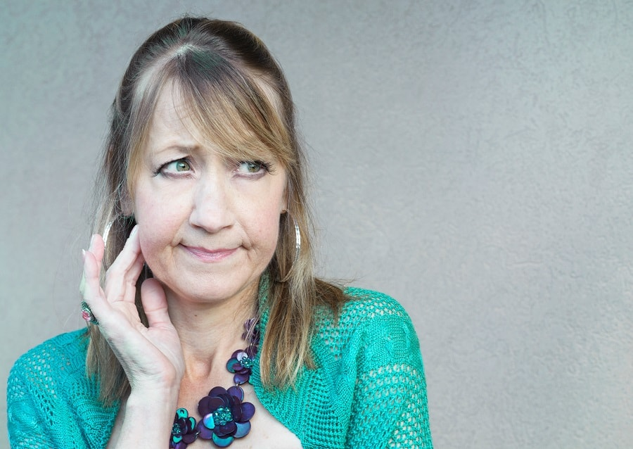 woman over 50 with bangs and highlights