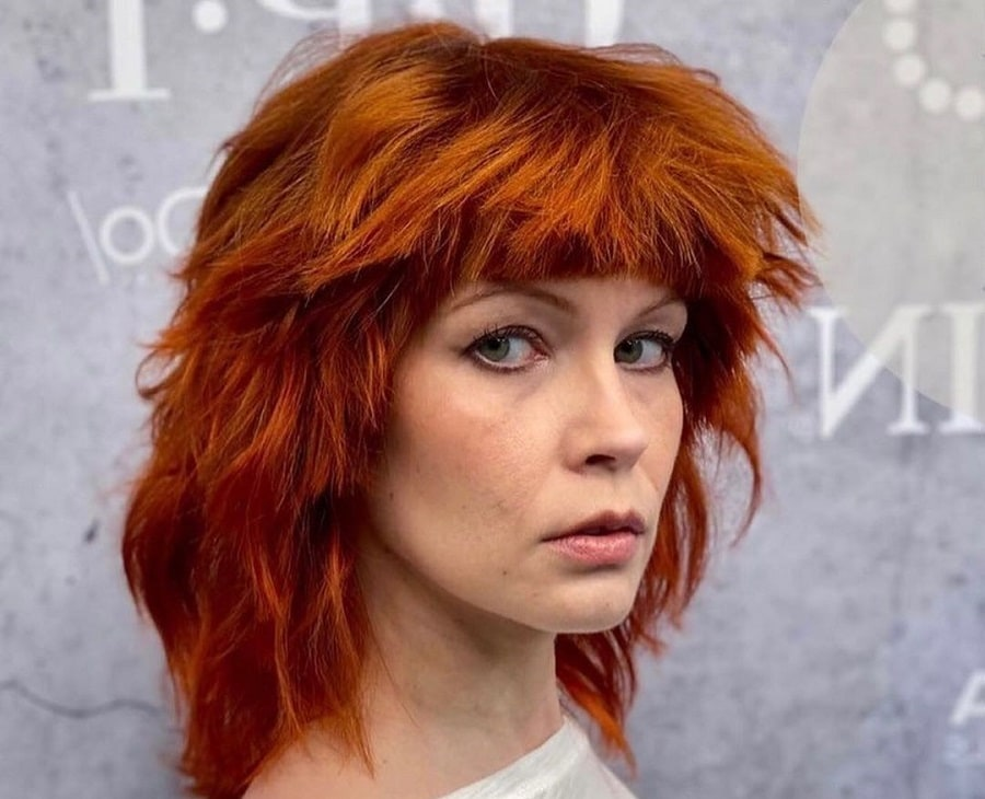 copper red shaggy hairstyle for woman over 50