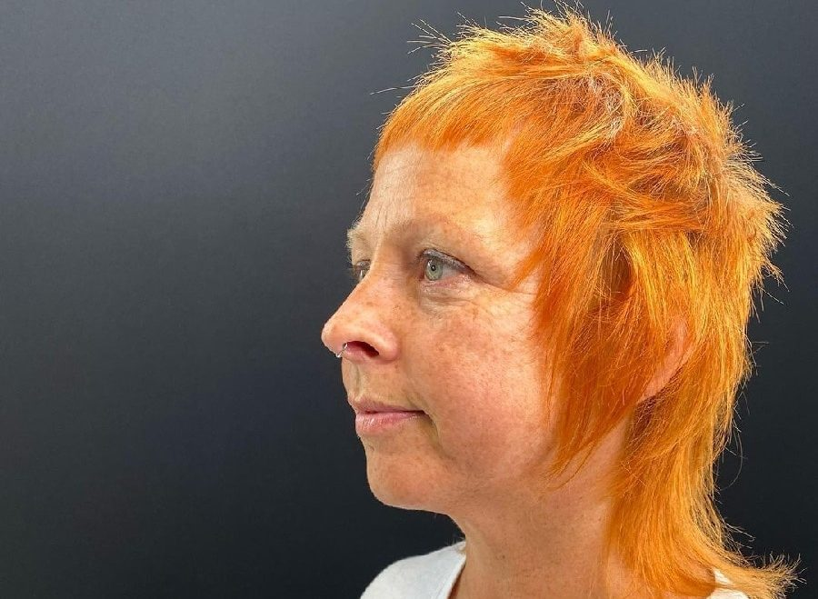 older woman with shaggy mullet hairstyle