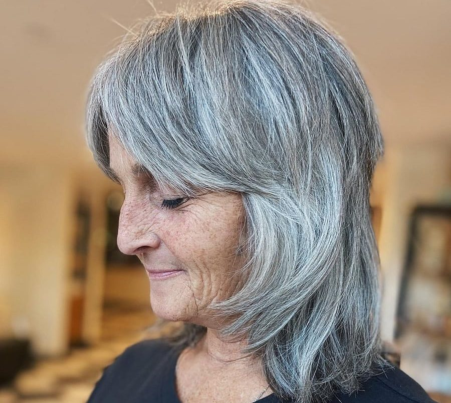 gray shaggy hairstyle for older woman