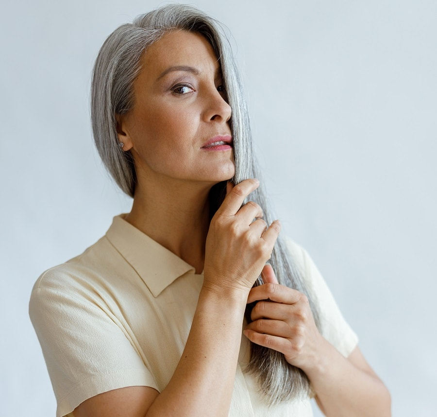 woman over 50 with long silver hair