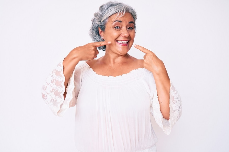 short curly silver hairstyle for women over 50