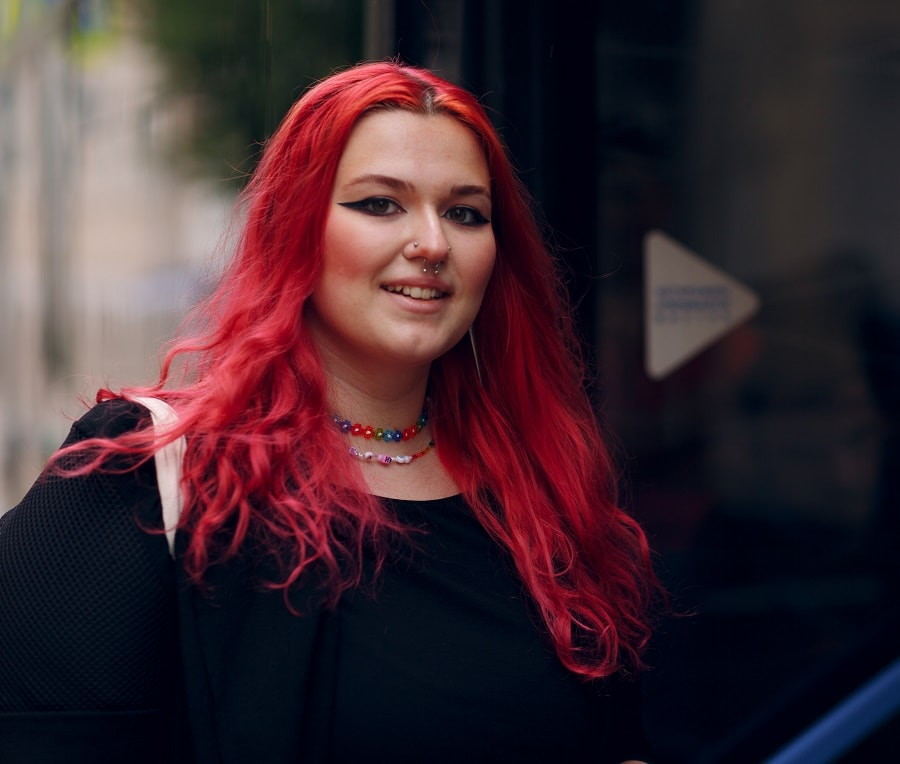 fat face woman with long red hair