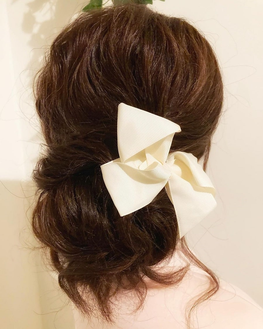 brunette medium updo with hairclip