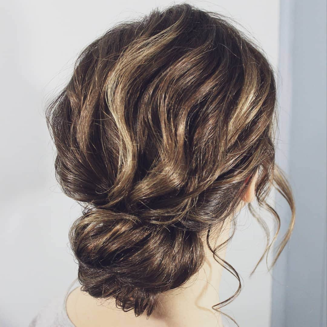 medium brunette bun with highlights