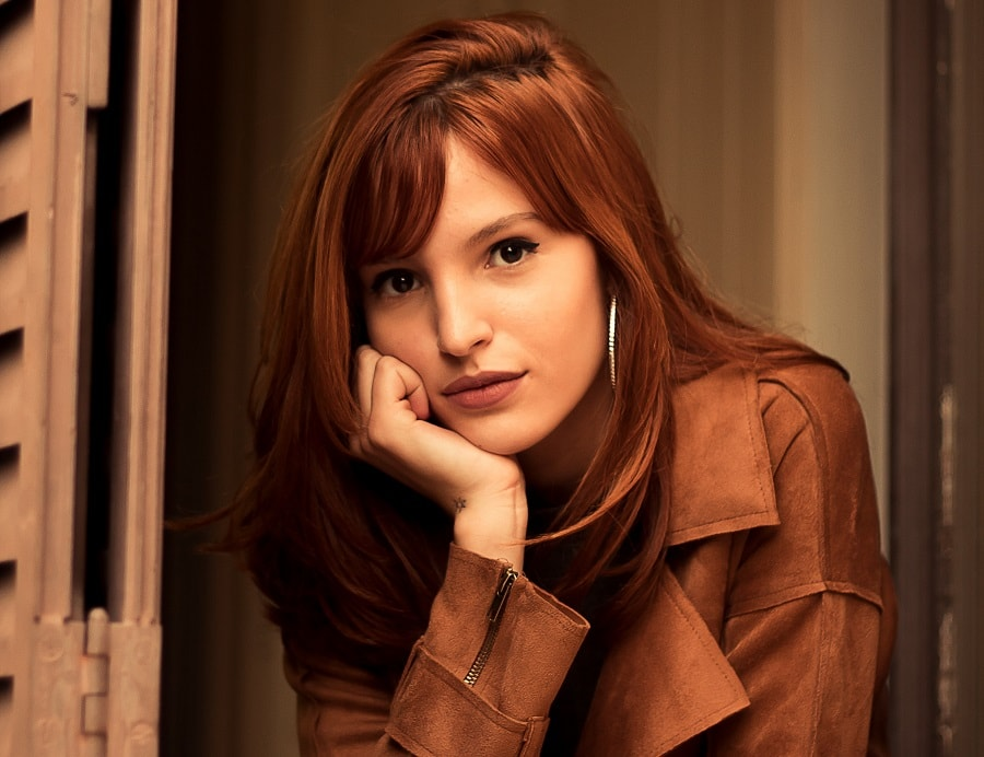 long copper brown hair with bangs