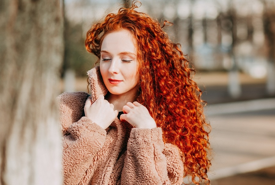 girl with curly long copper hair
