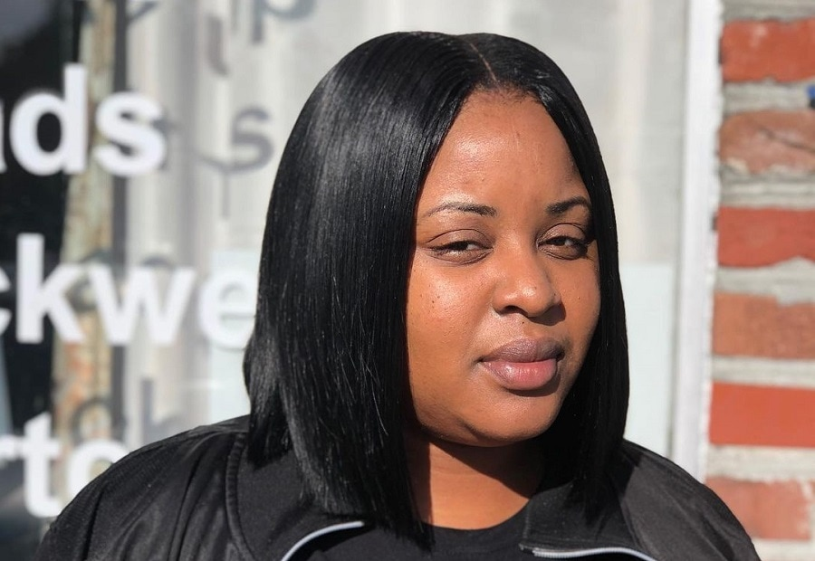 black woman with sleek medium straight hair