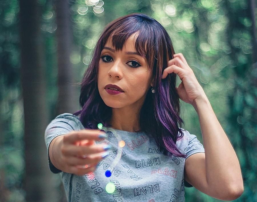 medium straight hair with purple highlights