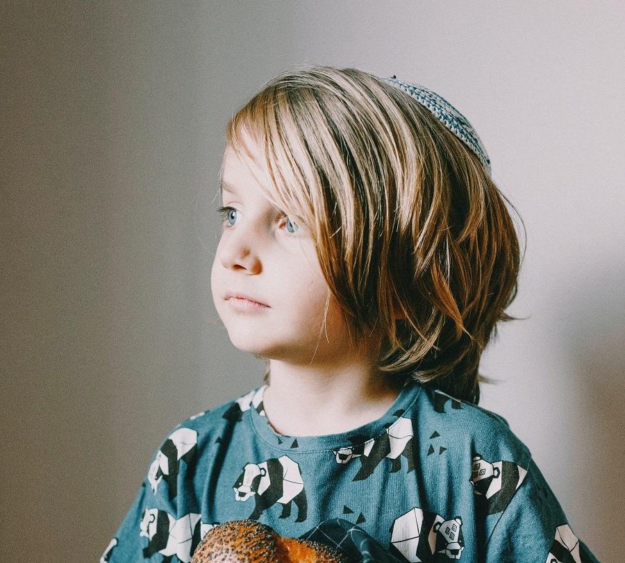 little boy with long blonde hair