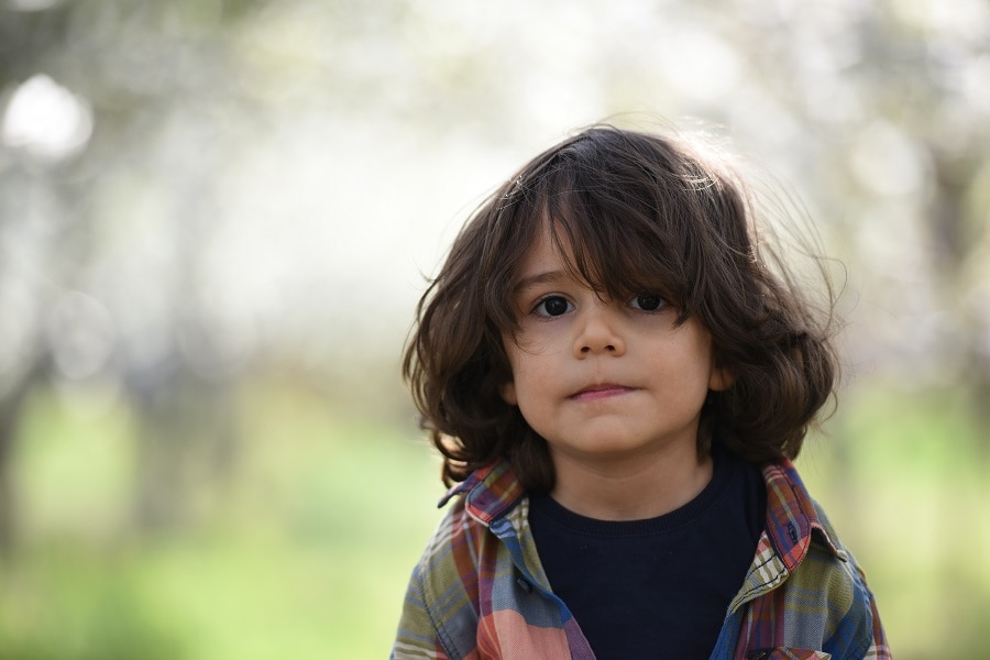 long messy hairstyle for little boys
