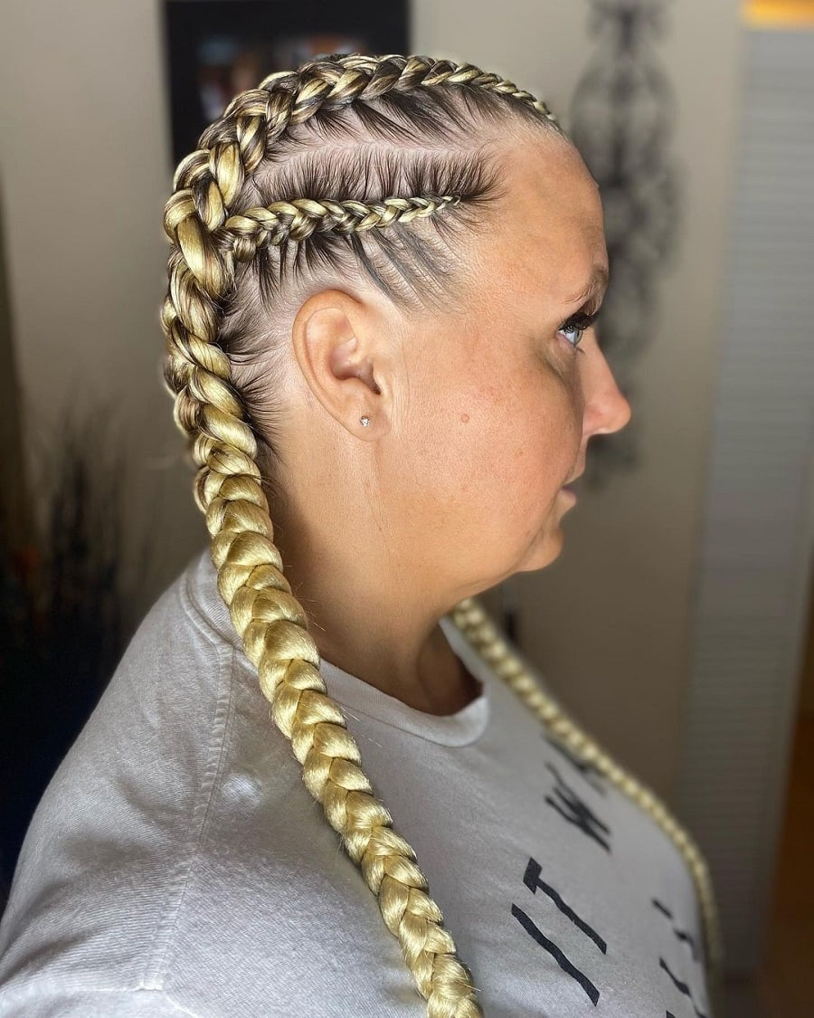 older woman with blonde boxer braids