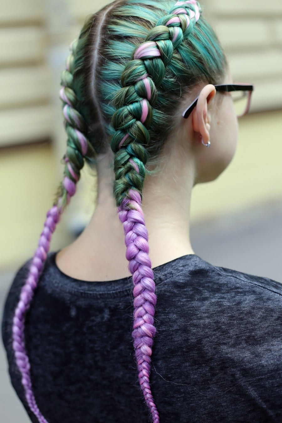 pastel green and purple toned boxer braids