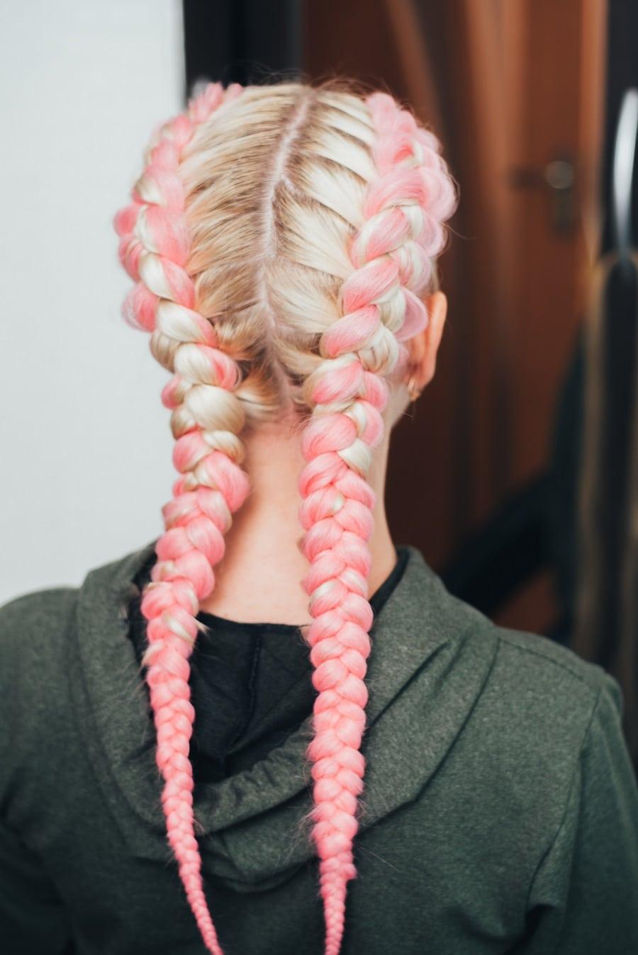 pastel pink boxer braids on blonde hair