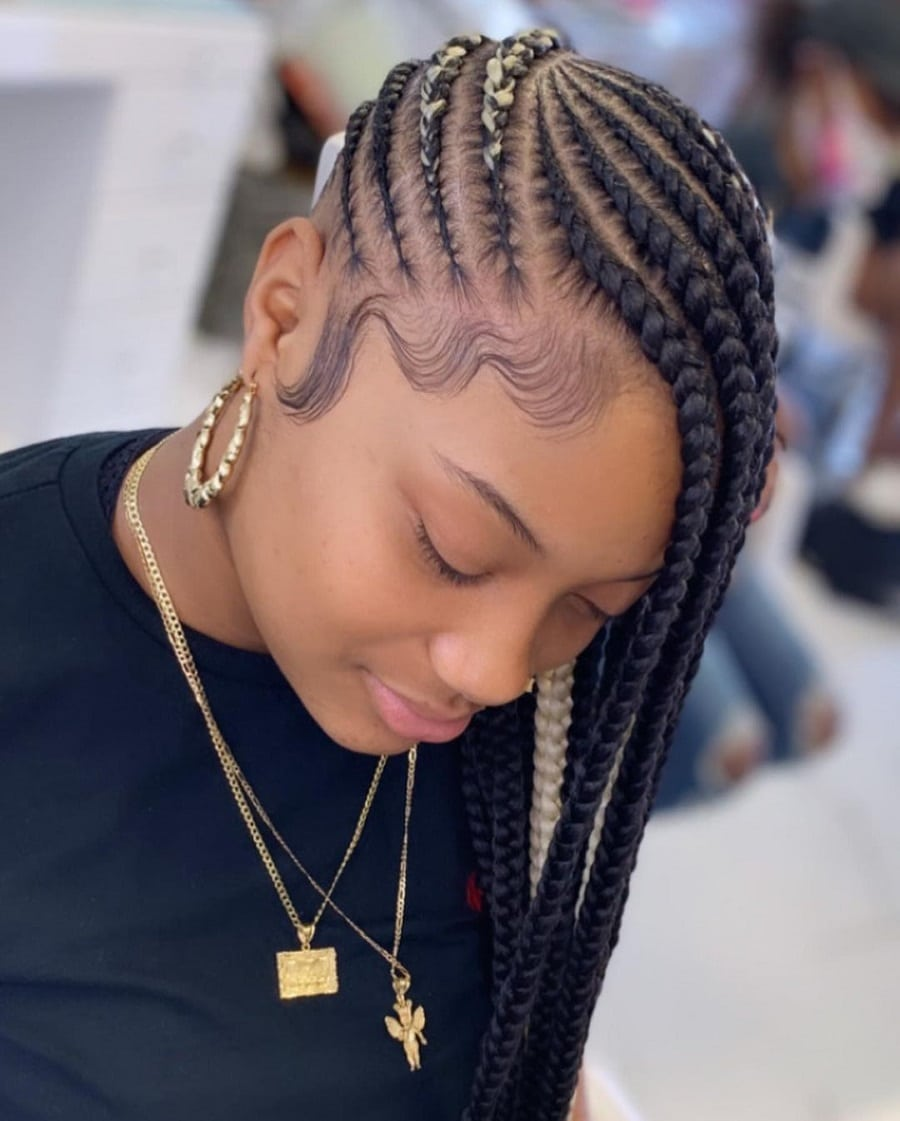 black girl with side swept feed braids