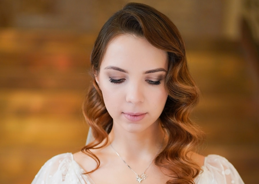 wedding hairstyle with long brown curly hair