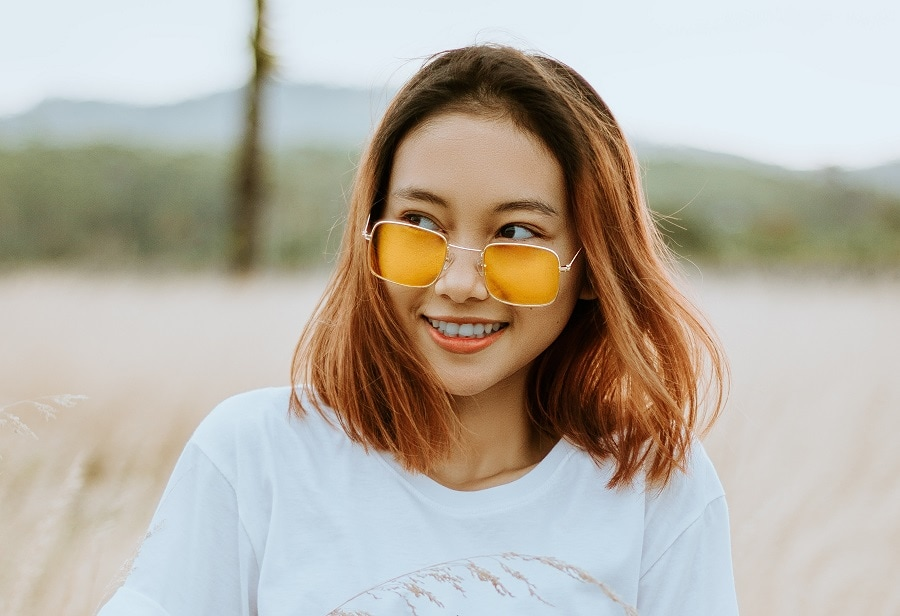 Asian girl with medium brown bob