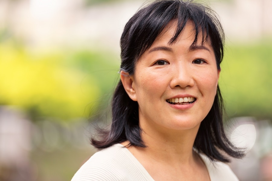 older Asian woman with medium hairstyle