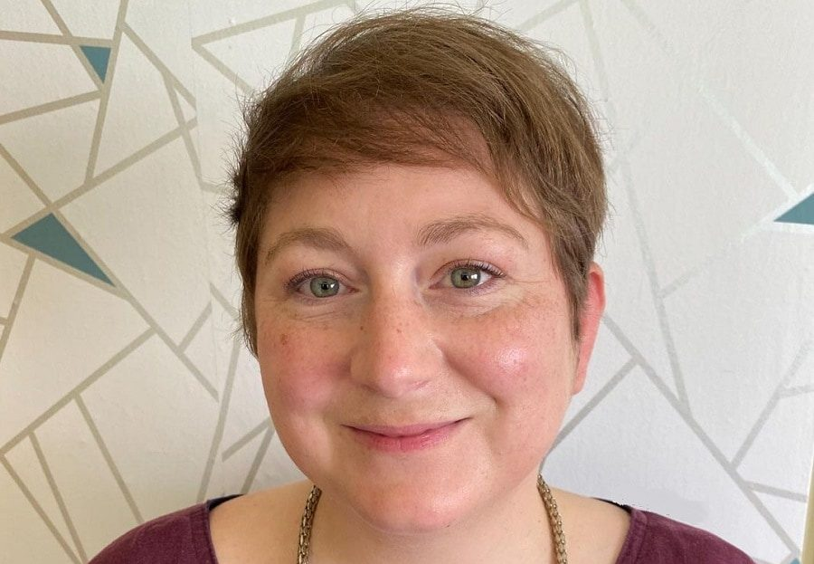 round face woman with short pixie cut