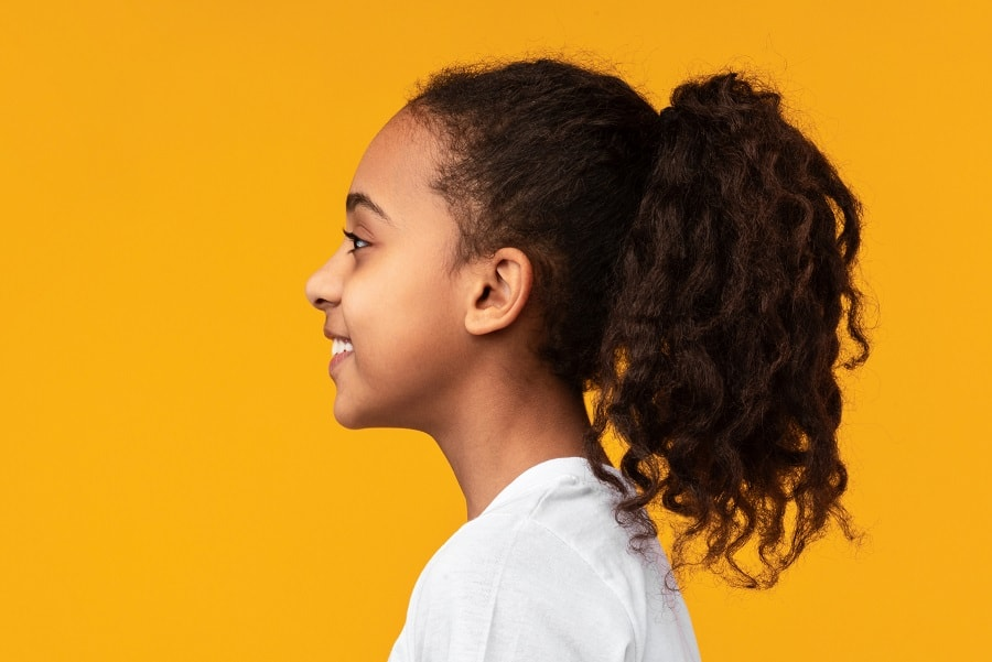 black kid with curly ponytail