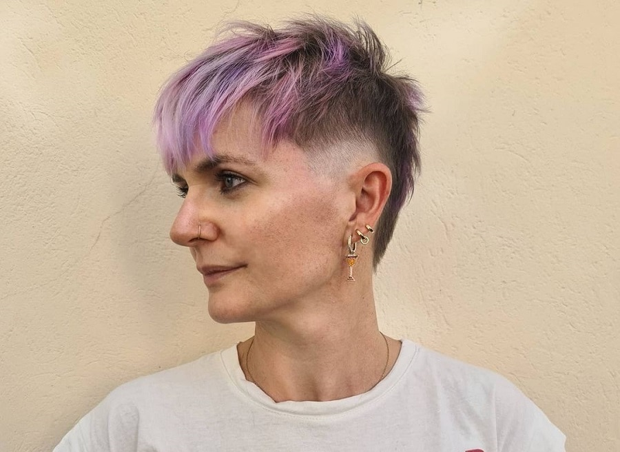edgy pixie cut with purple highlights