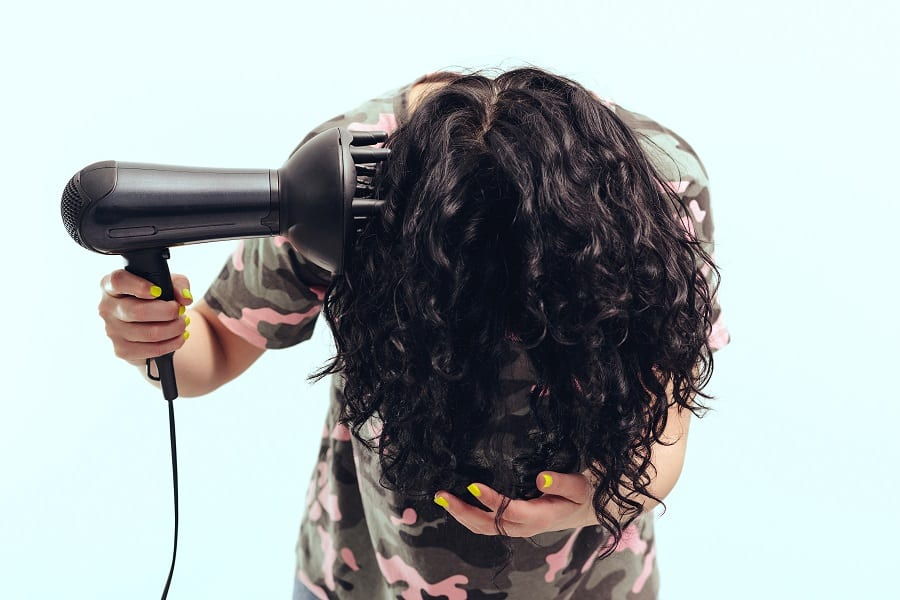 flip down curly hair to blow dry with a diffuser