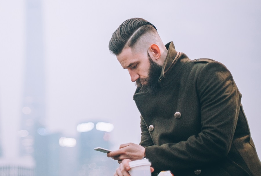 slicked back hairstyle with bald fade