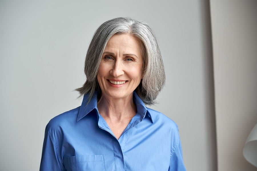 medium grey bob with thick hair for older woman