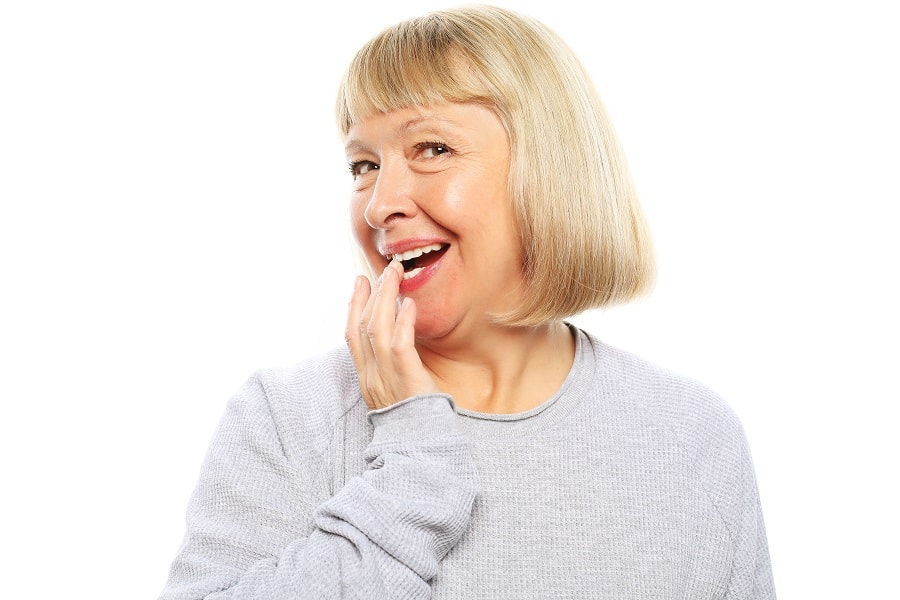 woman over 50 with bob cut and bangs