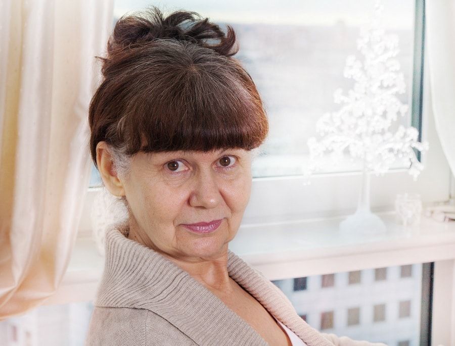 woman over 50 with thick bangs