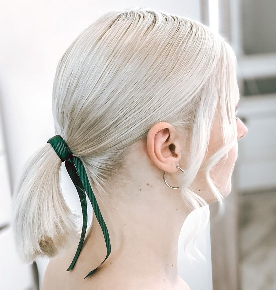 short platinum blonde hair with ponytail